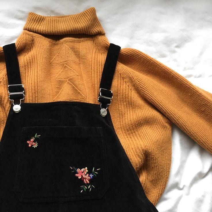 Photo of black embroiled overall outfits with a mustard yellow turtleneck sweater. Visit …