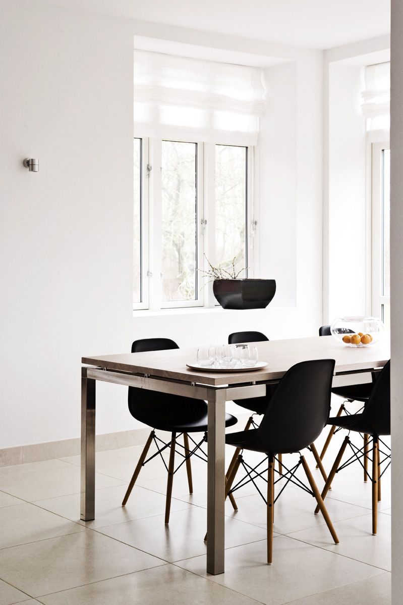 Spacious Dining Room. Black Eames Chairs