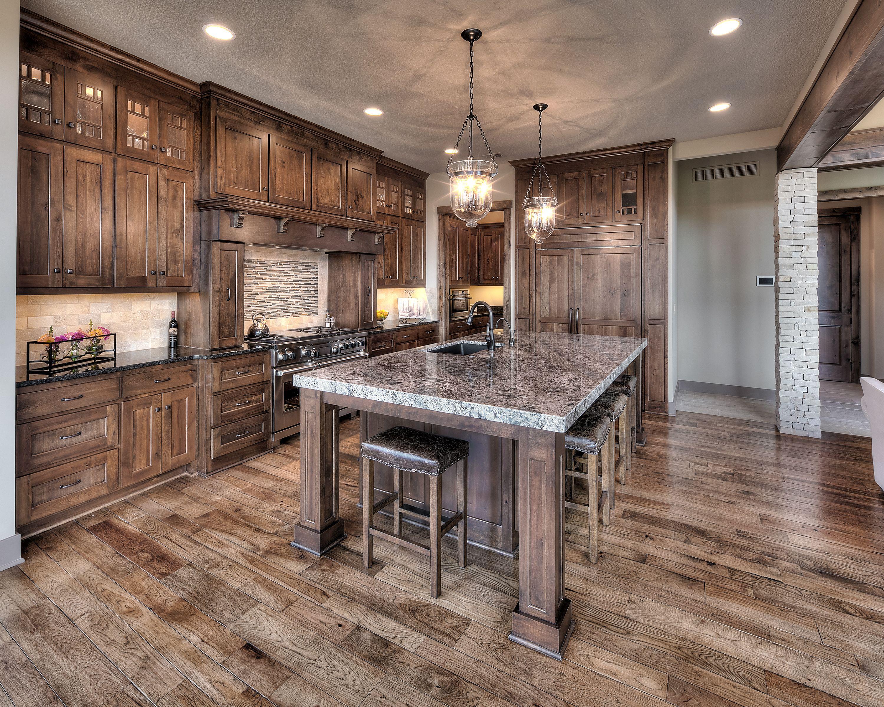 Kitchen: Dark hardwood, large kitchen island, cabinet ...