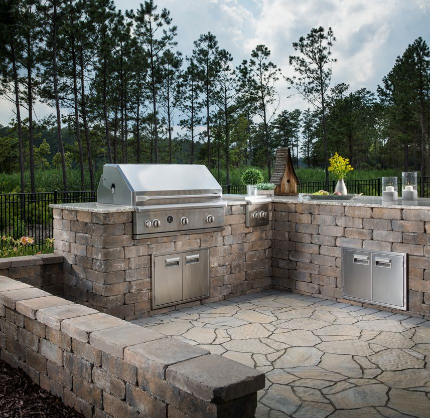 the sleek look of the stainless steel pairs nicely with the stone like blocks and the natural on outdoor kitchen natural id=97860