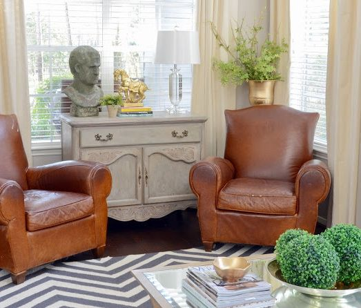 fun gold living room decor. The stone bust from HomeGoods made a fun unexpected statement in this living  space