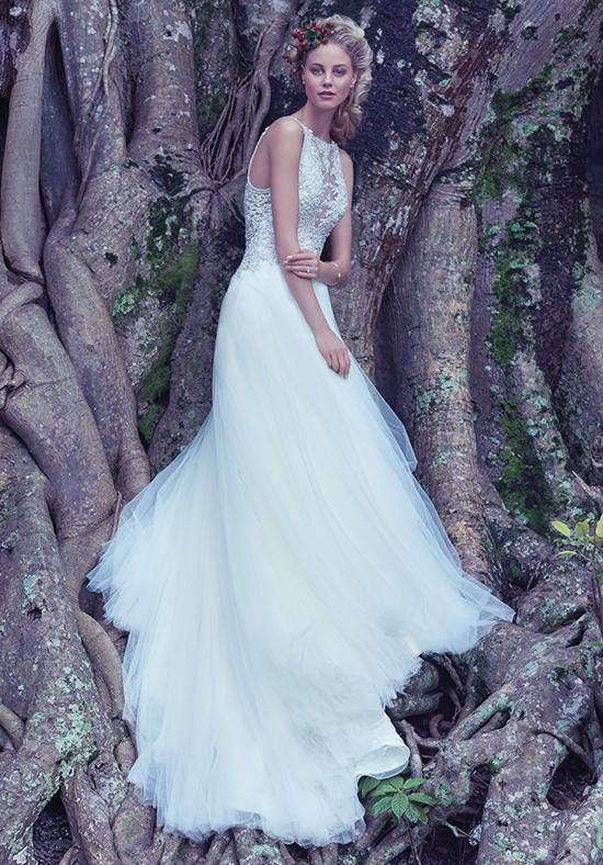 Illusion ball gown with beaded bodice, tulle skirt, and embroidered lace I Style: Lisette I by Maggie Sottero I https://www.theknot.com/fashion/lisette-maggie-sottero-wedding-dress?utm_source=pinterest.com&utm_medium=social&utm_content=sug2016&utm_campaign=beauty-fashion&utm_simplereach=?sr_share=pinterest