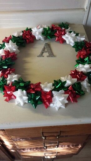Making own wreath. Just need christmas bows, wire wreath, hot glue gun and some time! Super easy super fun!