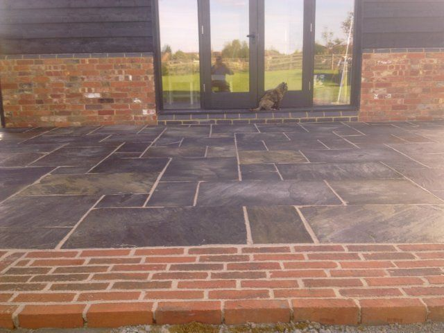 Black sandstone google search sandstone google house for Red brick patio ideas