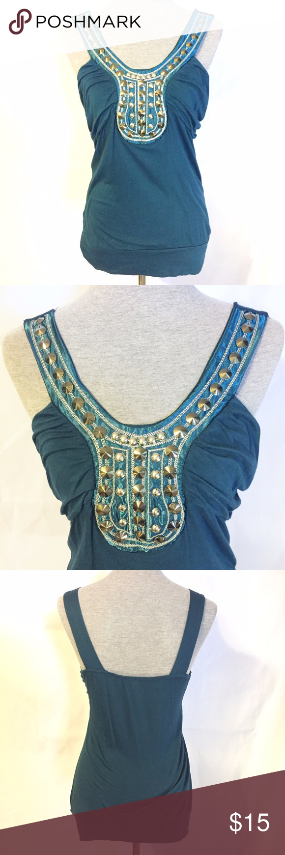 "Dark Teal Sleeveless Blouse Wet Seal Large Super fun embellished sleeveless blouse from Wet Seal! Beautiful gem toned turquoise color with silver stitching, beading and other embellishments. Love this top! There is a small hole in the waist band that I didn't even see until I was folding it up to put away after pictures. Very inconspicuous and not noticeable. 96% Rayon, 4% Spandex. 17"" Bust and 26"" Long laying flat. Size Large from Wet Seal Wet Seal Tops"