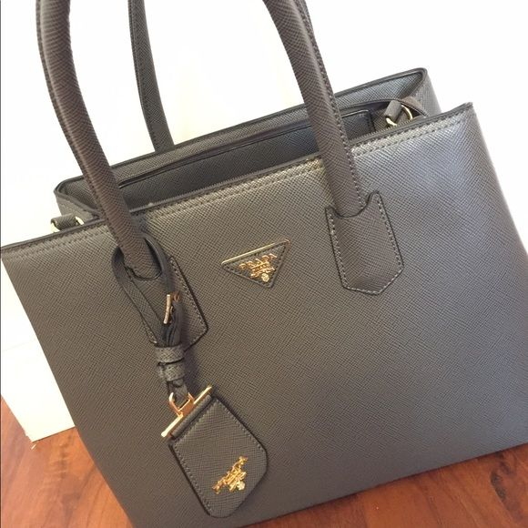 Shop Women's Gray size OS Clutches & Wristlets at a discounted price at Poshmark. Description: Gray Prada Purse for sale (dont ask the obvious) with a lot of space usea once. Sold by daniduqued. Fast delivery, full service customer support.