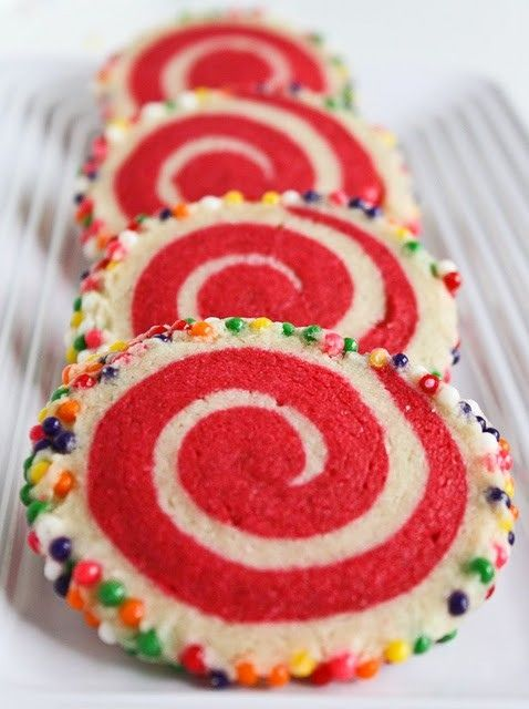 christmas cookies sugar cookie dough could add flavoring sugar cookie dough tinted red sprinkles roll out white dough roll red dough layer on top of