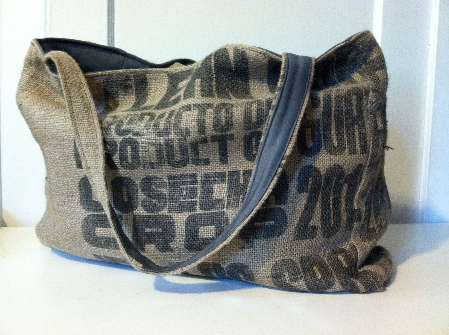 Burlap tote with black graphics and grey lining. $58.00, via Etsy.