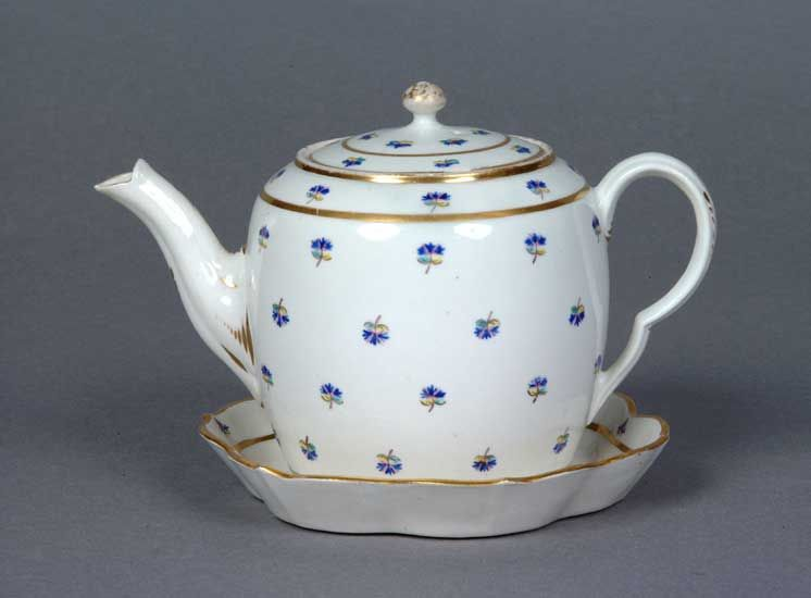 Porcelain Teapot, Cover and Stand, enamelled French Sprigs, 1785-1790. French style sprig designs were also produced in overglaze enamel and were particularly popular in the 1780s.