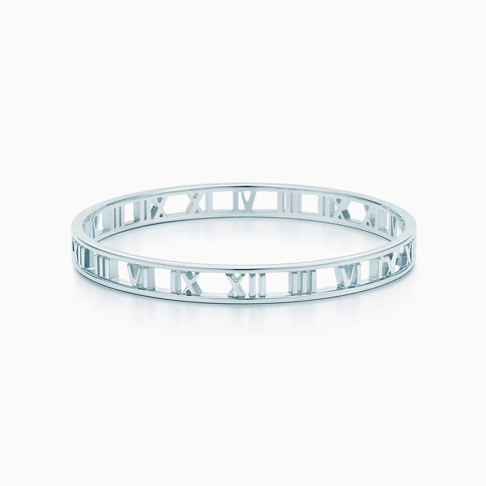 ac4b5a4a8 Atlas® narrow pierced hinged bangle in sterling silver with sapphires,  small. | Tiffany & Co.