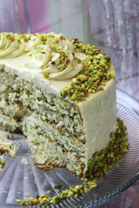 must try pistachio cake; a rich fluffy and moist pistachio cake (made with ground pistachios, oil and butter, and buttermilk); filled with an amazing pistachio paste cream cheese buttercream made fluffier with marshmallow fluff and whipped cream; covered in a must try pistachio paste cream cheese german buttercream #marshmallowflufffrosting