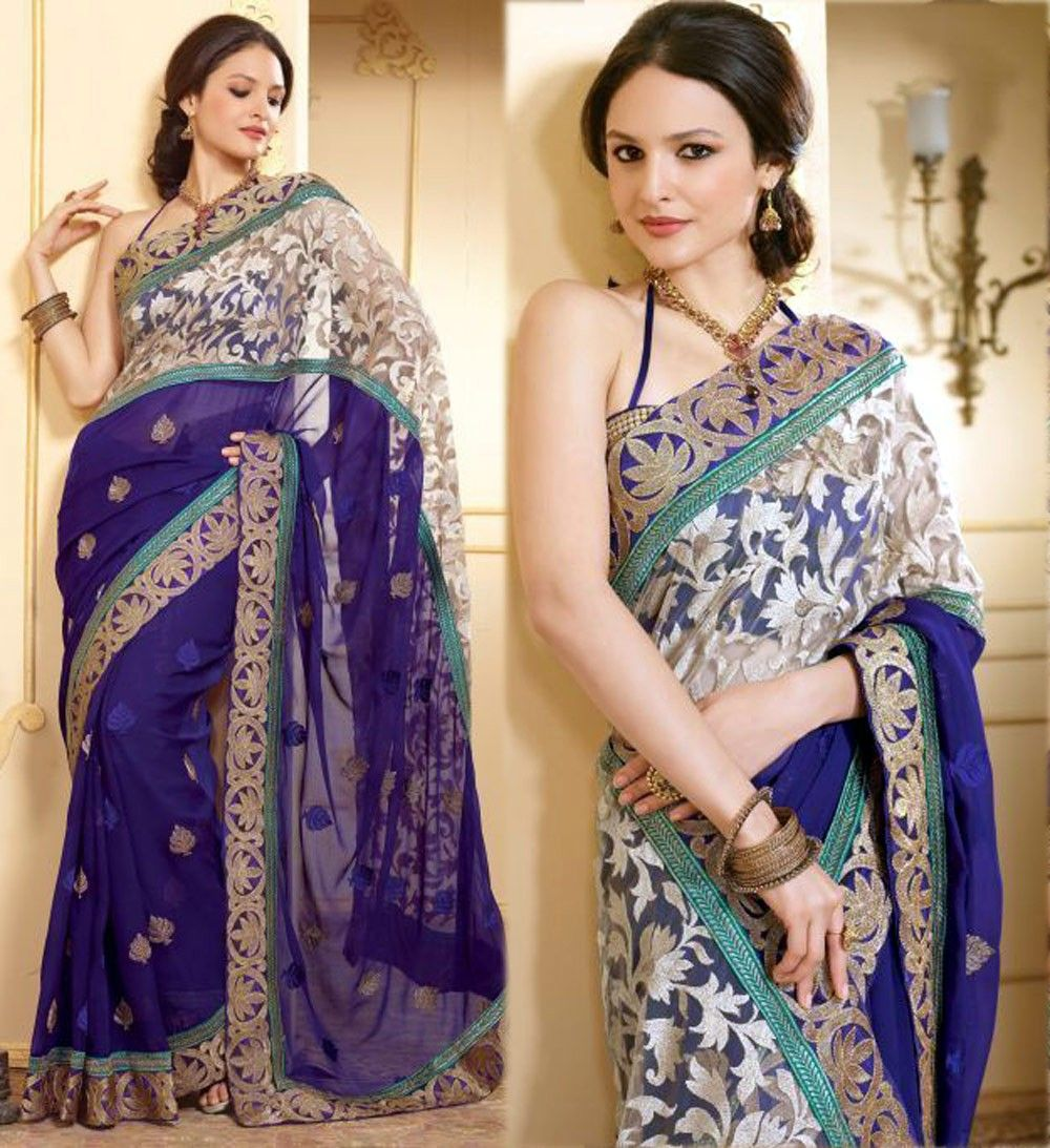 Attract compliments by this bige brown nvy blue chiffon u net saree