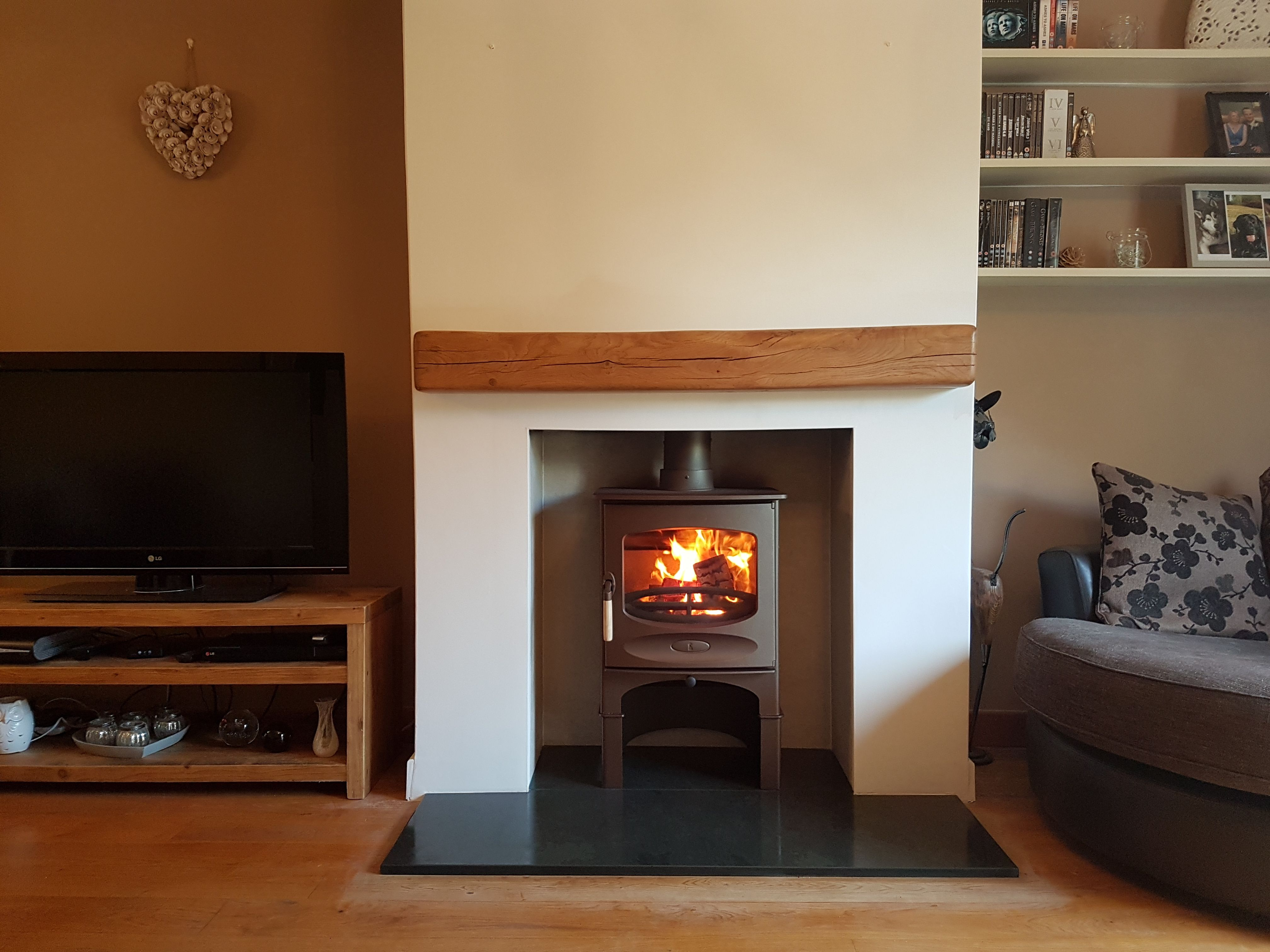 charnwood c five in bronze on store stand with a new slate hearth