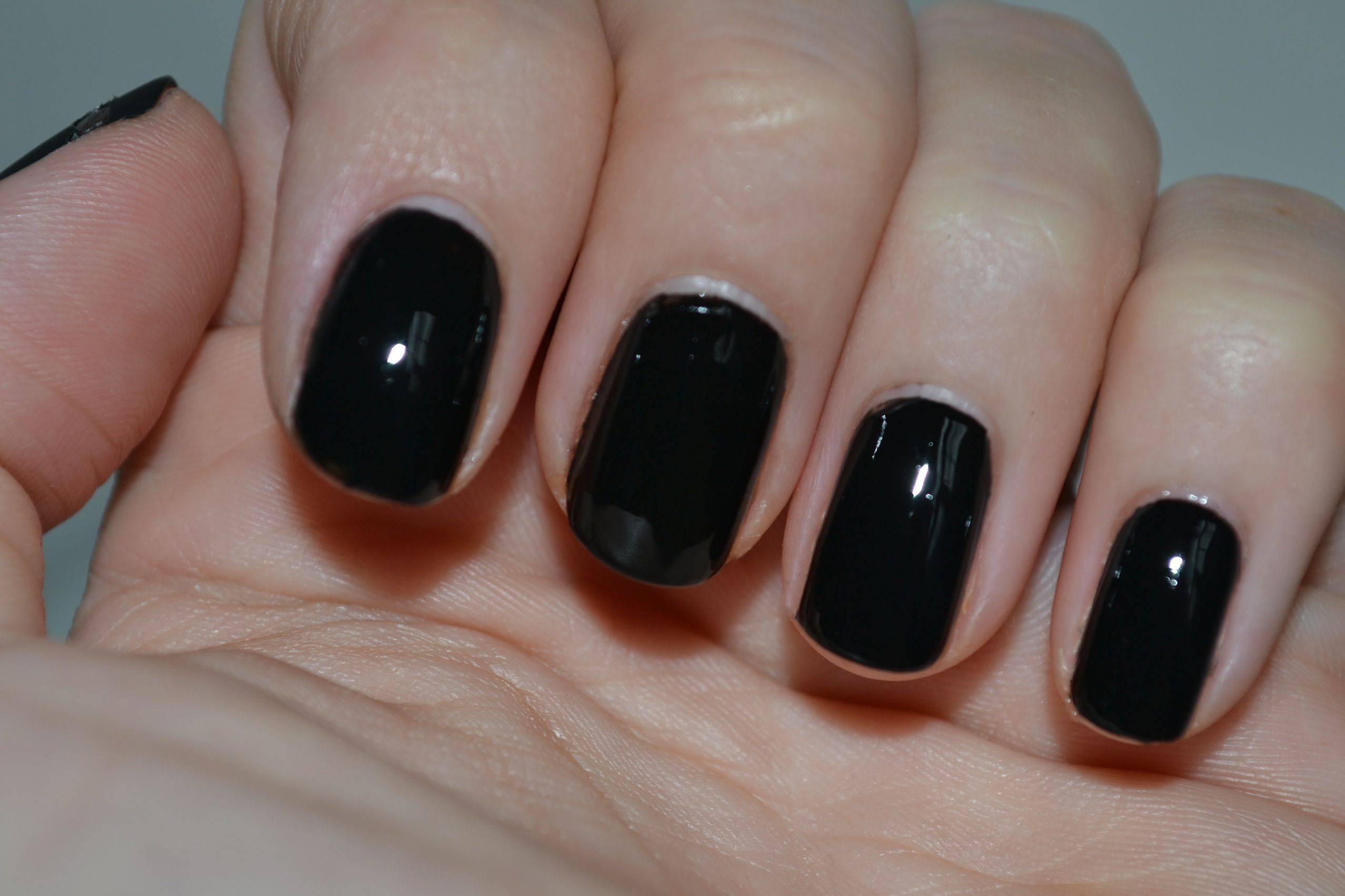 black nail polish | First, paint your nails with Essie Licorice ...