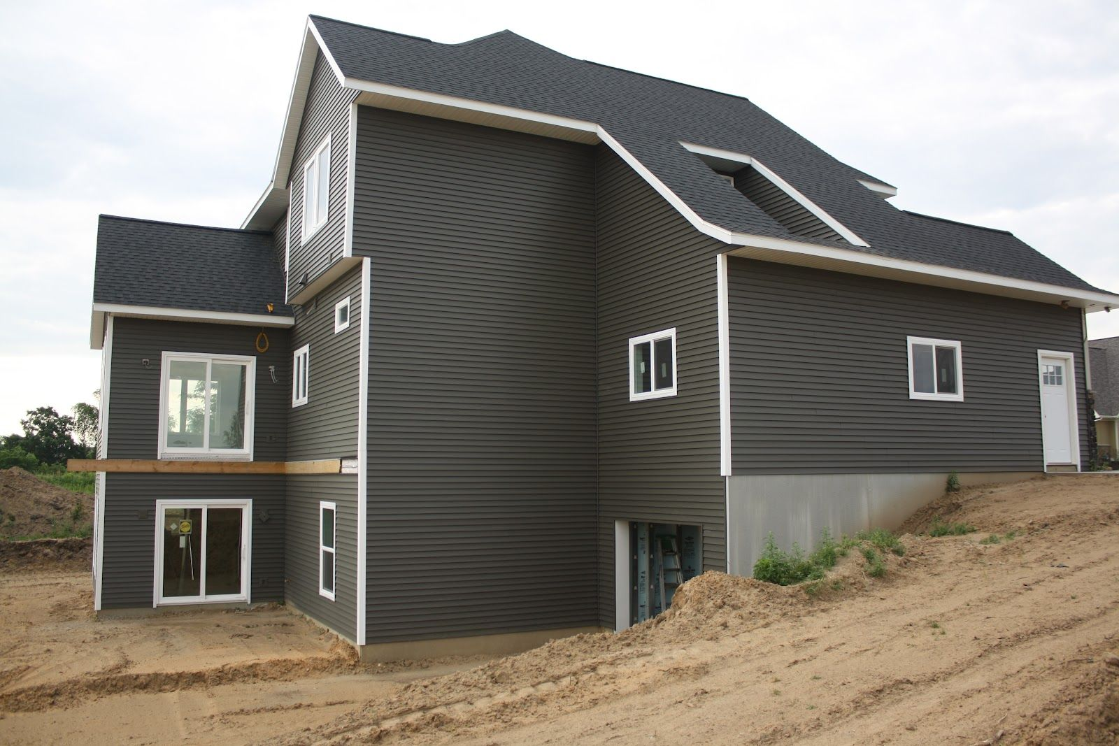 House on tufton the build exterior stone siding and for Vinyl siding colors on houses