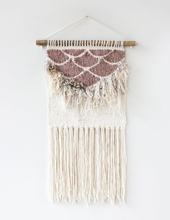 All girl with a touch of sparkle. This weave is long and fringe-y. Its simple color palette and organic texture will bring attention to any wall