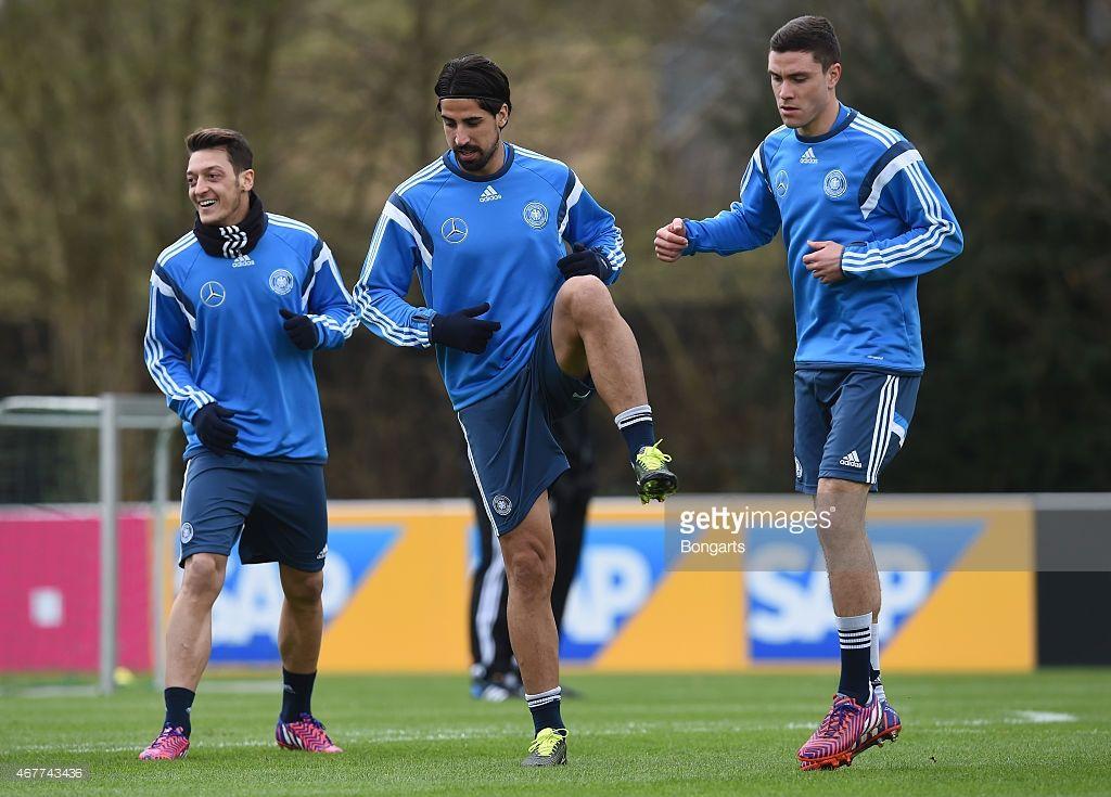 Mesut Oezil , Sami Khedira and Jonas Hector warm up during
