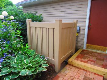 Vinyl Picket Fence Cover For An Ac Heat Pump Compressor
