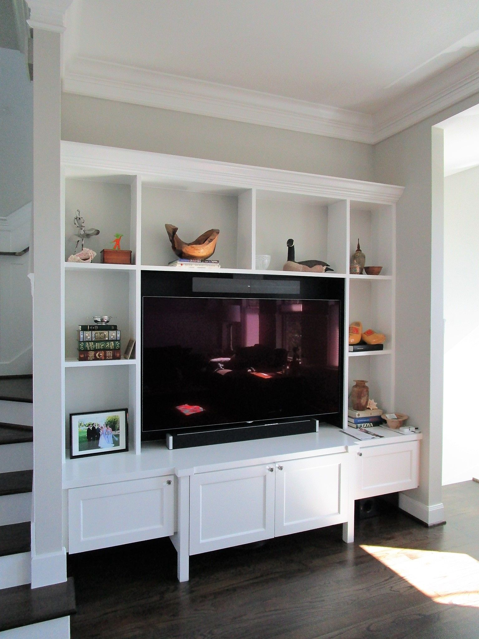 Clean simple entertainment center built around a clients