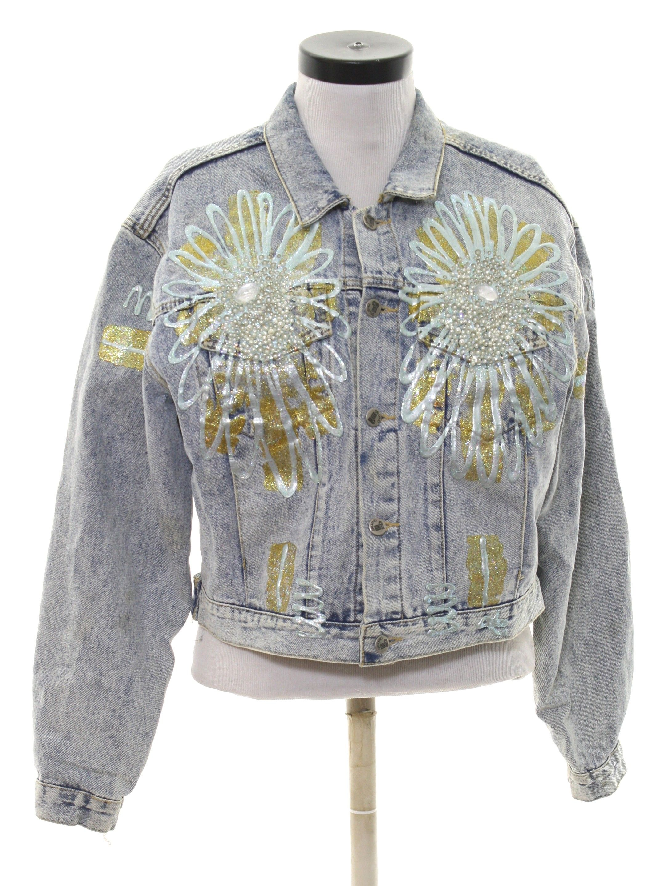 1980's Cavatino Womens Totally 80s Acid Washed Denim Jacket is part of Vintage Clothes Grunge - Late 80s Cavatino Womens blue acid washed background cotton denim button cuff longsleeve button front totally 80s acid washed denim jacket  Jacket has fancy glittery white and gold floral puff painting on both sides of the front chest and sleeves with faux pearl detail  Fold over collar  Two lower front side entry inset pockets and square waistline  Inside is unlined  The back of the jacket has more puff painting across the shoulders  Some of the pearls are missing from the front, can add some of your own or wear as is and there is some light yellowing on the lower button front (not very noticeable)