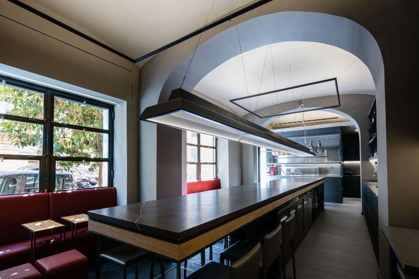 Insula studio completes la petrilleria an intimate deli for Studio design roma