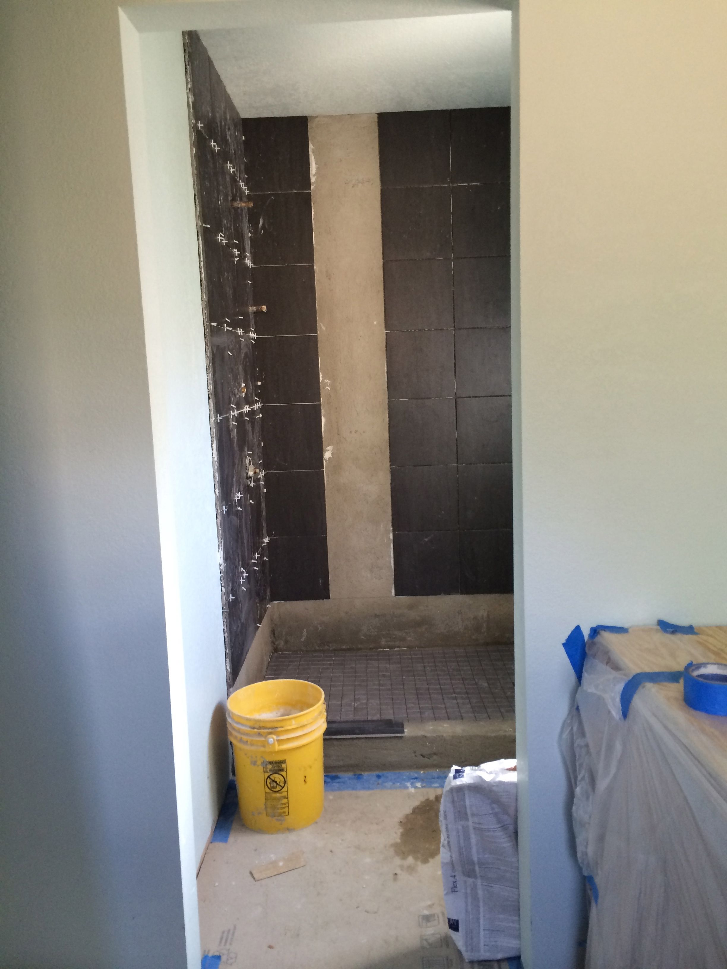 Day 15 tiling the side walls of the shower and pan for Bath remodel timeline