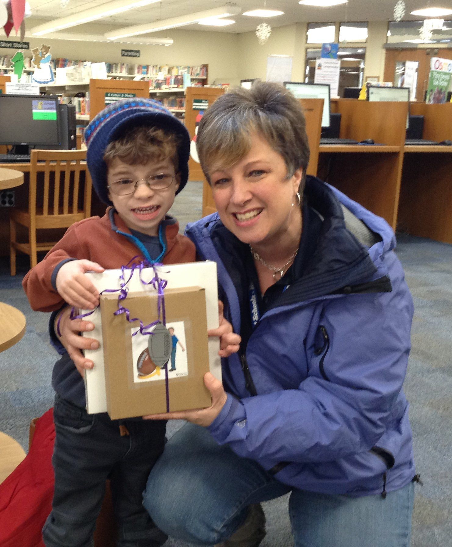 """Congrats to Nicholas (& his mom!) for winning our Super Bowl """"Saturday"""" raffle! 🏈"""