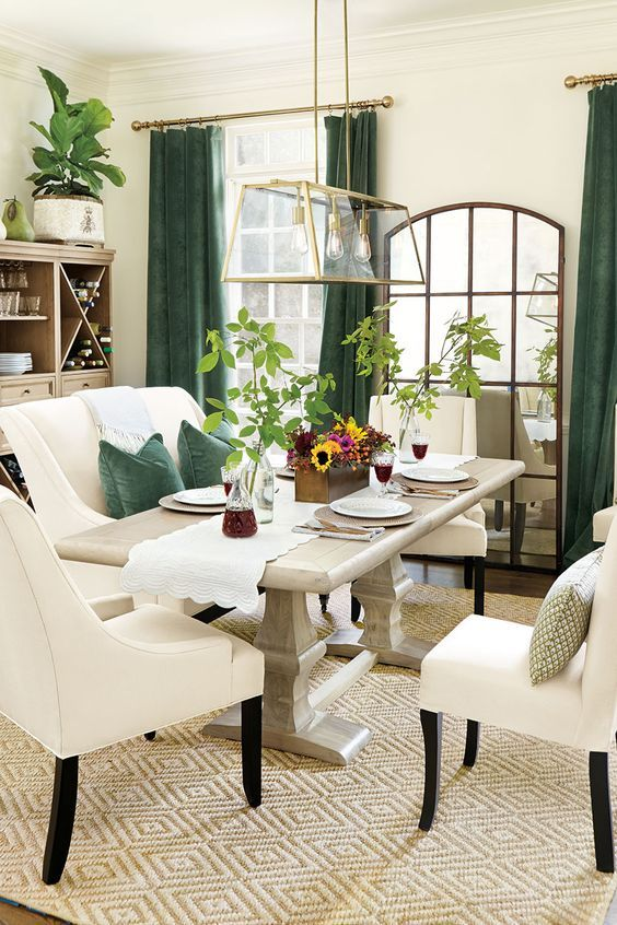 Chic Elegant Dining Room With Green Velvet Curtains And Matching Pillows