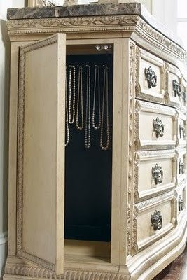 Decorated panel in cabinet as a secret compartment.  Make it into a double secret door that leads to a different room