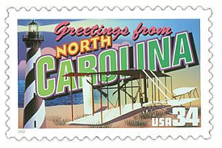 The North Carolina State Postage Stamp  Depicted above is the North Carolina state 34 cent stamp from the Greetings From America commemorative stamp series. The United States Postal Service released this stamp on April 4, 2002. The retro design of this stamp resembles the large letter postcards that were popular with tourists in the 1930's and 1940's.