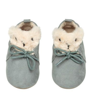 Blue. Soft slippers in faux suede with a teddy-bear-shaped tongue and lacing at front. Faux fur lining and insoles. Faux suede soles.