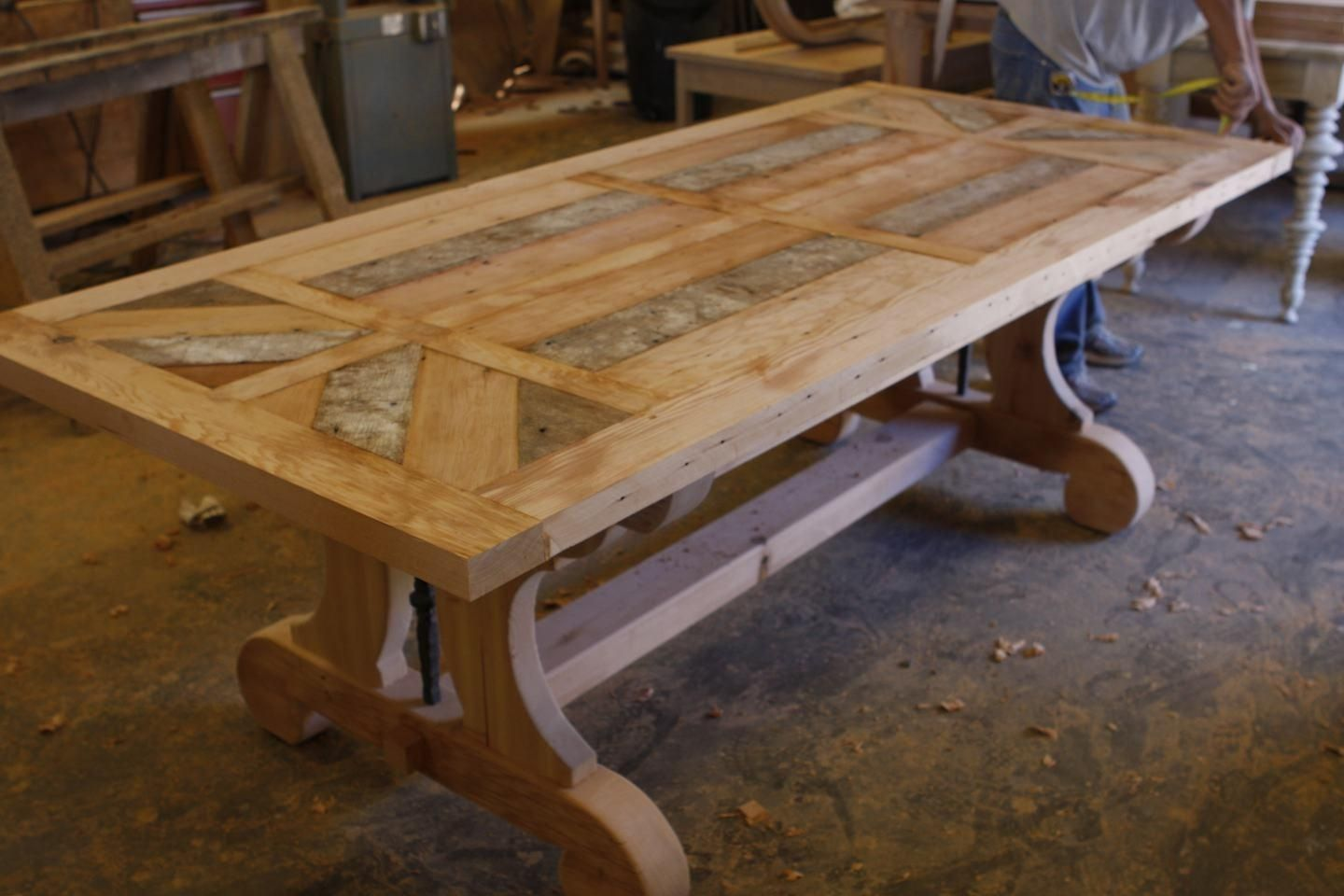 Custom trestle dining table with leaf extensions built in reclaimed wood