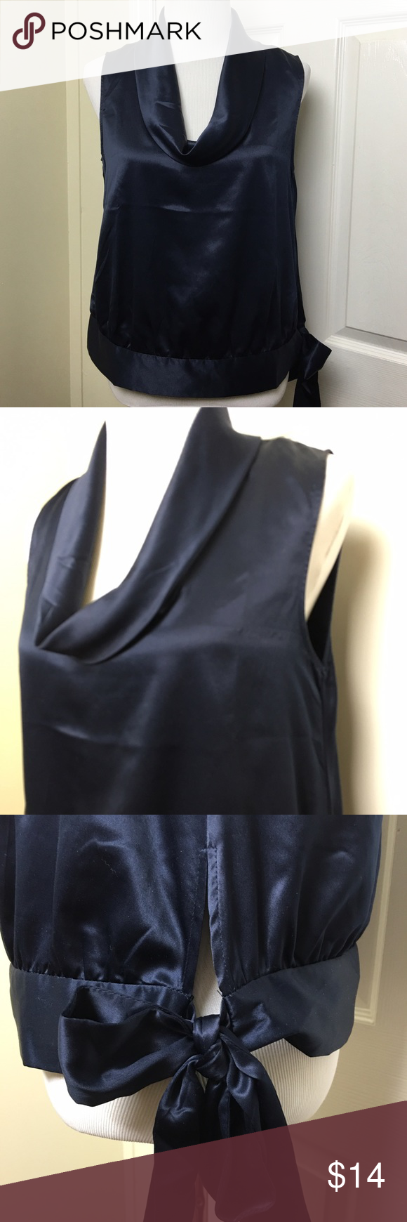 Banana Republic Navy Blue Top Banana Republic sleeveless top featuring draped cowl neck. Super soft fabric. Banded waist with self tie on side. Banana Republic Tops