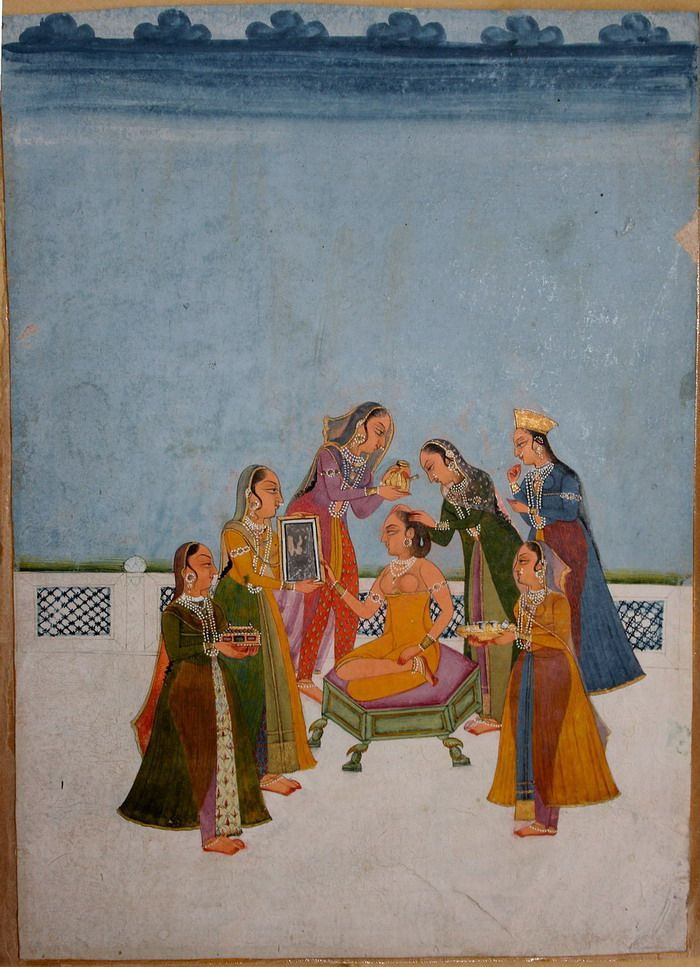 Vilaval Ragini, 5 Maids help to  make up the lady, one holds scent, one a box of jewelry, one a mirror, one make-up while one dresses her hair. A lady oversees. Jodhpur, India ragamala -late 18th C.