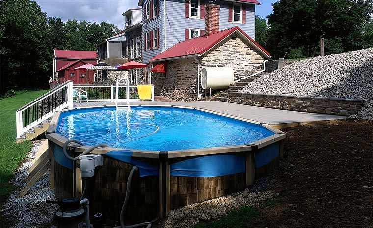Above ground pool landscaping gallery landscapes for Hillside pool ideas