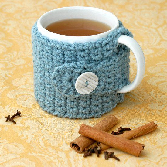 Free pattern for a quick charming coffee cozy. Great for holiday gift giving or for that special tea or coffee drinking friend.