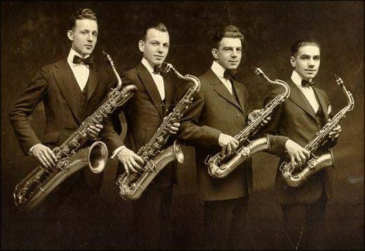 Sax quartet (possibly 1920's) with bari, tenor, C-melody ...