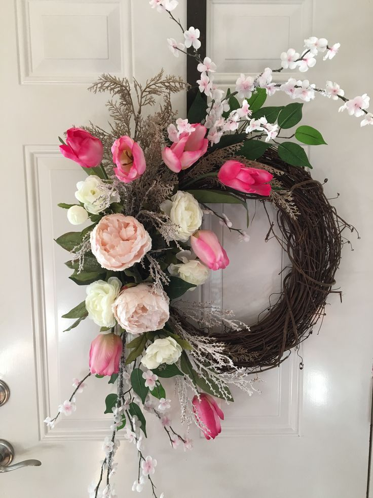Photo of Pink cherry blossoms and tulips by RVA Custom Door Decor