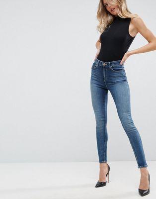9a5bb9c0d976 ASOS DESIGN Ridley high waist skinny jeans in extreme dark stonewash blue