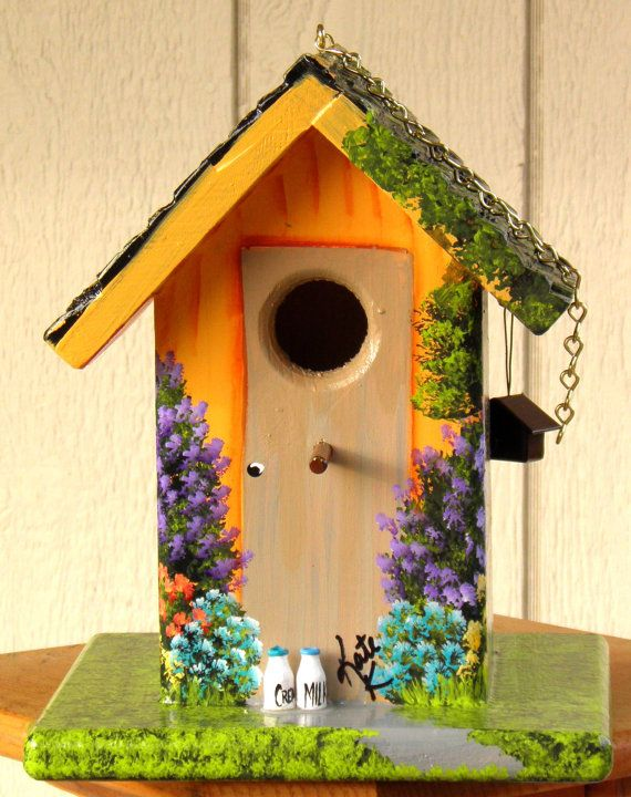 Hand painted bird house orange with colorful flowers for Birdhouse ideas