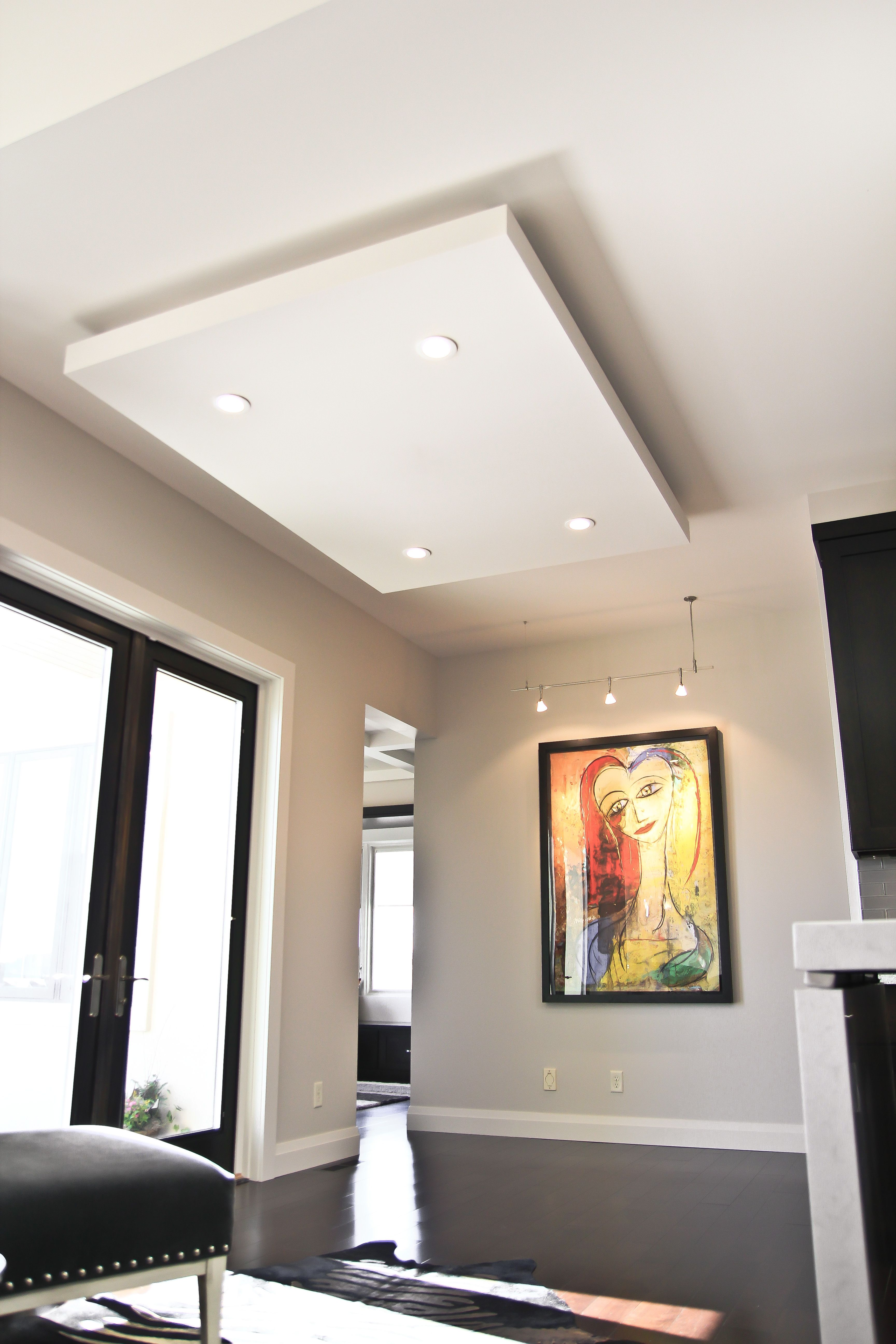 """""""Floating"""" ceiling adds dimension to this contemporary ..."""