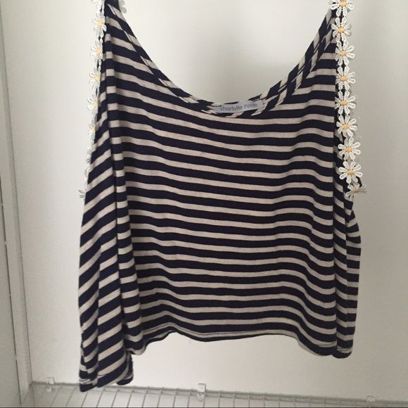 Charlottle Russe Daisy Crop Top Navy and white striped crop top from Charlotte Russe with daisies on the straps. They don't sell these anymore! Never worn. Charlotte Russe Tops Crop Tops