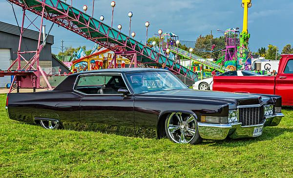 1970 Cadillac Deville 2.  Lain Low is the name of this beautiful 1970 Cadillac DeVille custom car at the Bolton Fall Fair in Ontario. With its sheer size, abundant chrome and lowered stance it is quite striking.