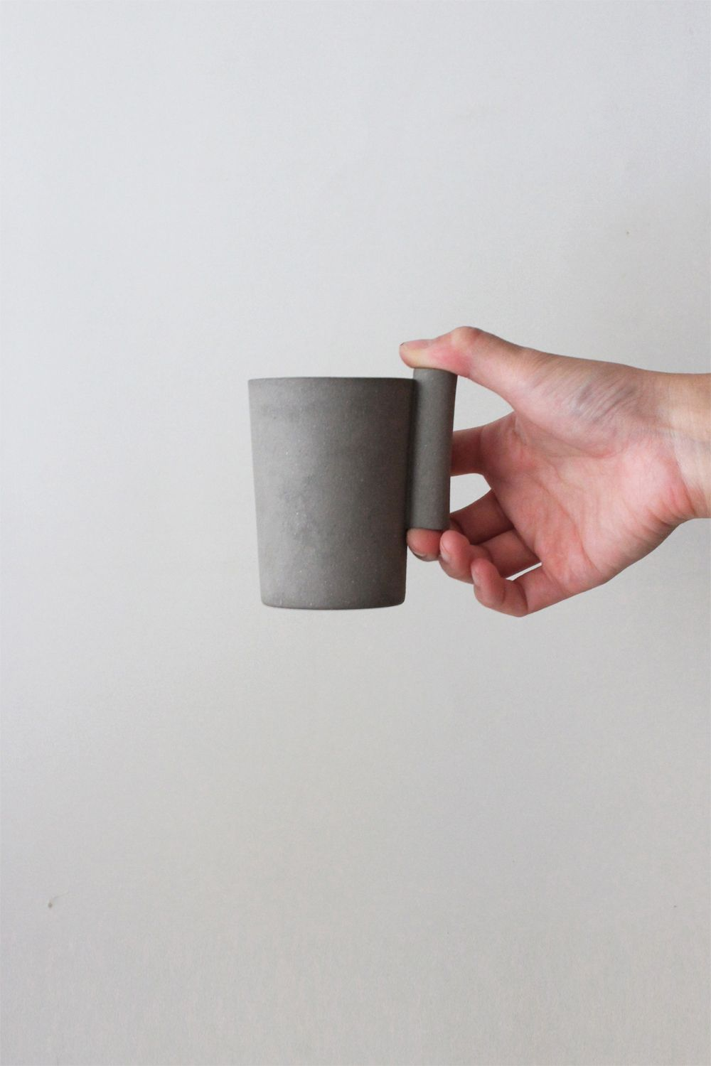 Designer Akiko Oue's Kop cup handle resembles handles of a different sort, door handles.