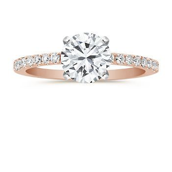 This elegant design features brilliant, hand-matched diamonds lining the top. Sixteen round diamonds in all, at approximately .20 carat total weight, cover this delicate ring in exquisite sparkle. The superior quality 14 karat rose gold setting pulls the look together. Simply add a center diamond in the shape and size of your choice. Shown with a center stone Brilliant Round Diamond.