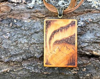Isn't this pretty?! - The Auroras - handmade and wood-burned pendants, made by Iona Wood Art