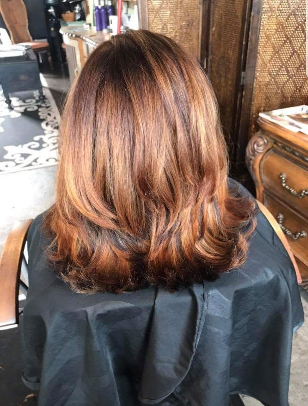 Love the richness and shimmer of this color caramel balayage on