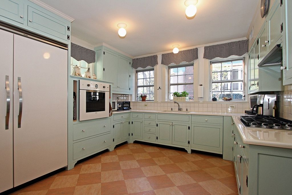 Country Kitchen With Complex Granite Tile Floors Inset Cabinets