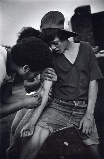 An 11 year-old boy tries heroin on rooftop. The Bronx, New York.     Photo circa 1977