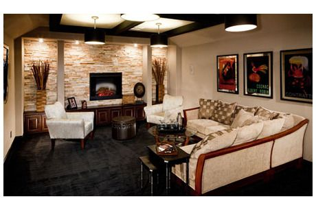Wall Homes San Antonio a lighted stone wall with white pillars frames the television set